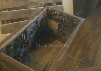 Intérieur coffre mécanique escape game.